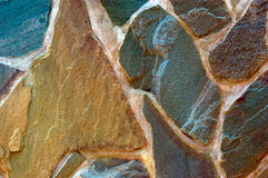 Stone surface of wall. Colored (prevaling brown) rough wall surface made of wild stones Royalty Free Stock Photography
