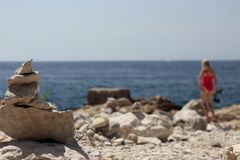 Stone symbol and girl with snorkeling equipment Stock Images