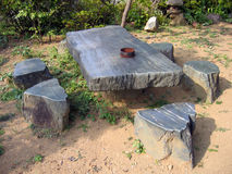 Stone table. With chairs in the garden of a buddhist temple in Japan. When I took the photo, I was thinking of removing the rusted ashtray, but after analysing Royalty Free Stock Photo