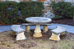Stone Table and Benches. Stone / concrete table and benches sitting outdoors stock photography