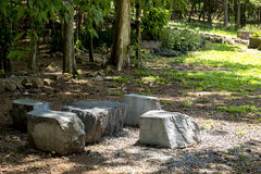 Stone table and chair in the garden. Royalty Free Stock Images