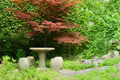Stone table and chairs Stock Images