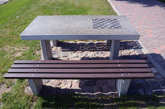 Stone table in city park with chessboard Stock Images