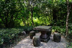 Stone table and drum-shaped stools in shade Stock Photo