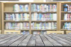 Stone table with library blur background.  stock photos