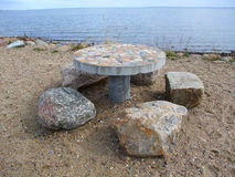 Stone table. On a sea coast Stock Images
