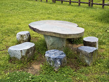 Stone table and seating benches in park Stock Images