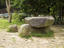 Stone table and seating benches in park Royalty Free Stock Photography
