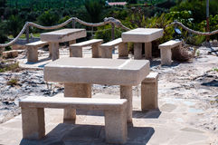 Stone tables. Ancient handmade stone tables outside Royalty Free Stock Photo