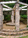 Stone temple in garden Royalty Free Stock Image