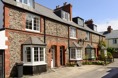 Stone terrace at Porlock, Somerset. View of old  terrace houses built with  stone and  in historic touristic village of  Somerset. Shot in bright light Royalty Free Stock Photography