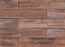 Stone texture. A wall of flat stacked stones in red color. For texture and background Royalty Free Stock Images