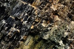 Stone texture, background. Ansient multi-layered surface of rocks stock image