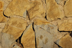 Stone texture. Broun. Big stone in the wall Royalty Free Stock Photos