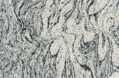 Stone texture. Granular texture of stone with curvy lines Stock Photo
