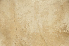 Stone texture. A sand colored stone wall texture with cracks stock images