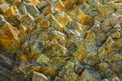 Colorful texture of volcanic rock in the background. Stock Photo