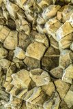 Stone texture vein of igneous rock in the background. Vein quartz igneous rock close up Royalty Free Stock Photo