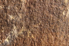 Stone texture. The texture of the stone on the wall is light brown in color stock image