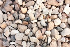 Stone texture, white light rock surface, pebble pattern, small gravel backdrop, abstract background, wallpaper. Empty template royalty free stock photo
