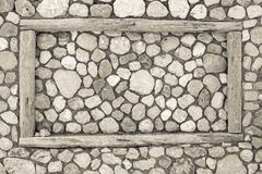 Stone texture with a wooden frame Royalty Free Stock Photography