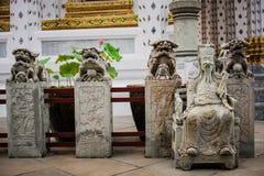 Stone  Thai-Chinese sculpture in Wat Arun buddhist temple in Bangkok, Thailand. Stock Photos