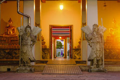 Stone Thai-Chinese style sculpture and thai door art architecture in Wat Pho temple, Thailand Stock Photo