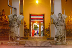 Stone Thai-Chinese style sculpture and thai door art architecture in Wat Pho temple, Thailand Stock Photography