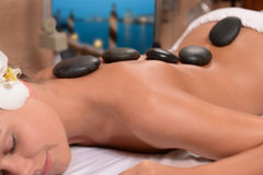 Stone Therapy. SPA massage and stone therapy Royalty Free Stock Photography
