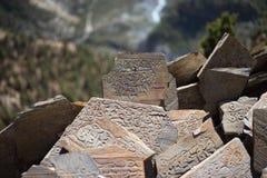 Stone with tibetian mantras Tibet sanscrit Royalty Free Stock Photo