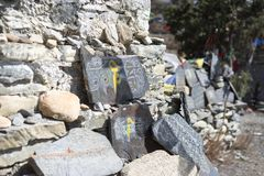 Stone with tibetian mantras Tibet sanscrit Royalty Free Stock Image