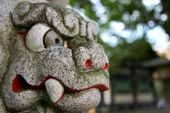 Stone tiger head. Closeup macro shot of stone oriental tiger head Royalty Free Stock Image