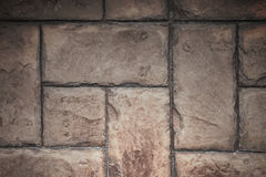 Stone Tile Cement Brick Wall Background Texture with Lighting fr. Om below Royalty Free Stock Photography