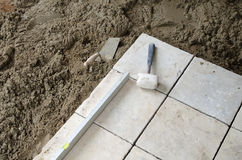 Stone tiles installation Stock Photos