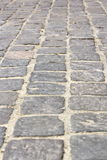 Stone tiles on pedestrian pathway Royalty Free Stock Images