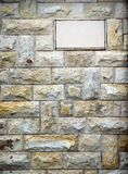 Stone tiles wall and empty board texture background Stock Photos