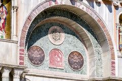 Tile stone made into an art display on St. Mark`s Basilica in Venice. Stone, time and stone carving decorates a wall of St. Mark`s Basilica in Venice Stock Photography