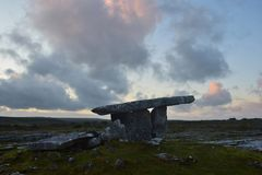The stone tomb Poulnabrone in the Burren in Ireland stock photo