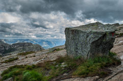 Stone with tourist sign in the mountains of Norway on the way to. Preikestolen Stock Photo