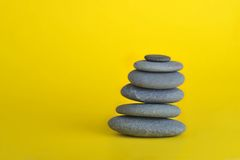 Stone tower. Isolated on yellow background Stock Photography