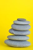 Stone tower. Isolated on yellow background Stock Images