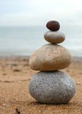 Stone tower. 4 stones stacked up on beach Royalty Free Stock Images