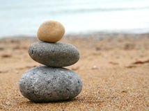 Stone tower. 3 stones stacked up on beach Stock Photos