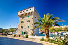 Stone tower in adriatic town of Marina Stock Photos