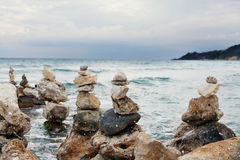 Stone tower against waves sea background for balance, meditation and zen theme. Stone tower against waves sea background for balance, meditation and zen theme Stock Photography