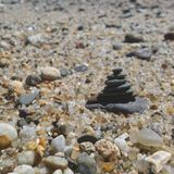 Stone tower amongst pebble beach stock photography