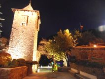 A stone tower in Andorra at night. stock images