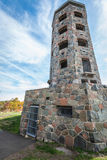 Stone tower in autumn. Stone tower in middle of a public park during autumn Royalty Free Stock Photos