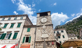 Stone tower clock in city of Kotor, Montenegro Stock Image