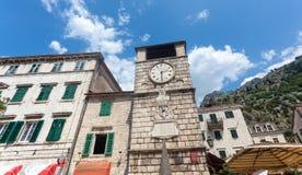 Stone tower clock in city of Kotor, Montenegro Stock Image